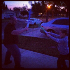 Father & Son Light Sabers at Sunset