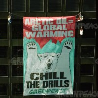 "A Greenpeace banner on the ARCO building  reading ""Arctic Oil = Global Warming, Chill the Drills."" 10/15/1997"