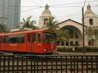 Trolley at Santa Fe Depot .It's hard to tell, but the driver is wearing a disposable dust mask. ( 1pm to 2 pm 27 Oct 2003)